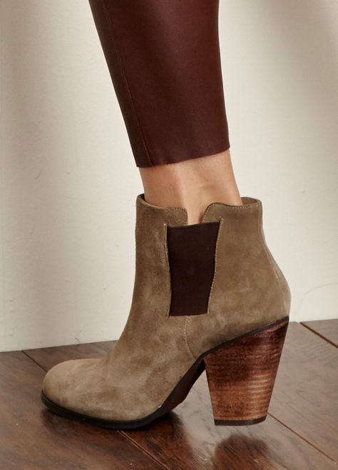Genuine suede booties with a stacked heel and elastic side bands for an easy on-and-off