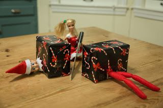 The Fun of Outdoor Movies: 50 Plus Elf on the Shelf Ideas Elf on the Shelf is cut in half by Barbie, Magic!