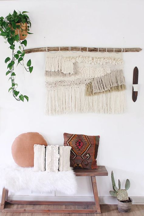 Add lots of texture to your home just by hanging something on the wall. A unique addition to your home, this weaving is hand-woven with textural natural fibers and hung on a wood piece. Hang in an entryway, living room, or bedroom for a boho touch.
