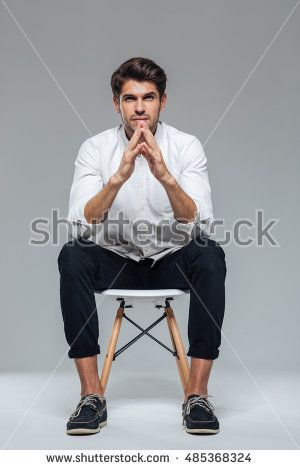Fancy White Sitting Chair Man Sitting On Chair Stock Images Royalty Free Images Vectors Sitting Pose Reference Man Sitting Sitting Poses