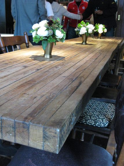 putting the planks on their ends for a DIY table top - would make a great rustic table for the back porch