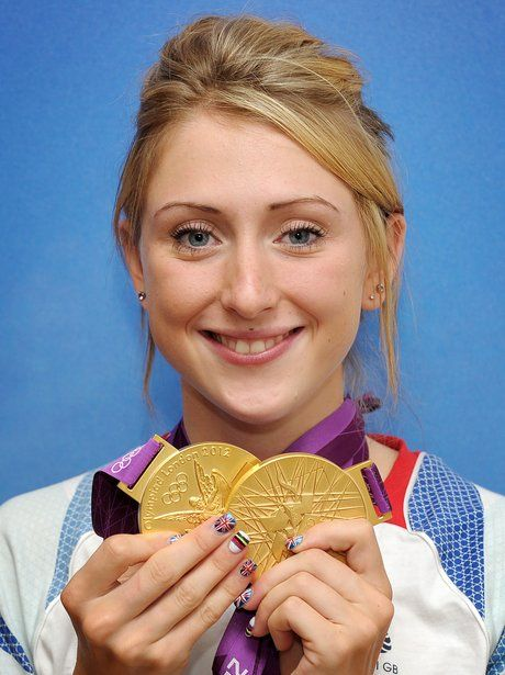 Laura Trott, the rising star of British cycling, poses with her two gold medals