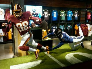 Display at the new Nike Store in D.C. Ray Rice is trying to tackle Brian Orakpo because logic.