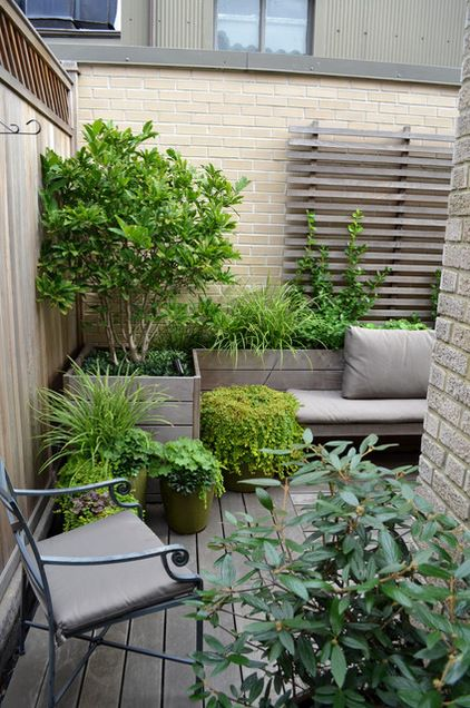 Small space turned bigger, thanks to soft neutrals  Traditional Porch by Jeffrey Erb Landscape Design