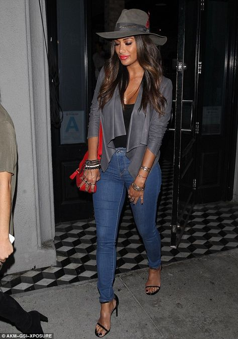 Looking good:Opting for a busty black top and skinny jeans that drew…