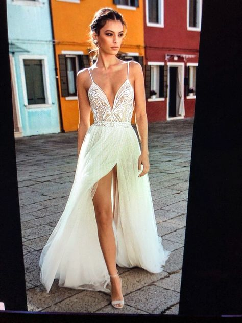 Beautiful beaded wedding dress. Brand new, never worn. Slit down the side but not revealing like the picture. I unfortunately gained weight so I have to re order it in a different size which is why I'm trying to get close to retail price! Thank you