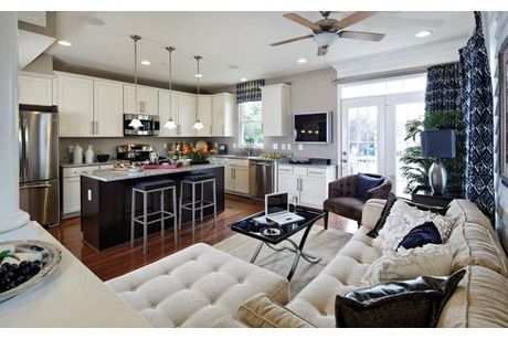 Sophisticated style is on display in this sleek, contemporary kitchen and great room. Luxury townhomes in the Woodlake community by Craftstar Homes. Burtonsville, MD.