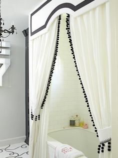 Black And White Bathroom Features Drop In Bathtub Adorned With Subway Tile Surround As Well Valance Along Double Shower Curtains