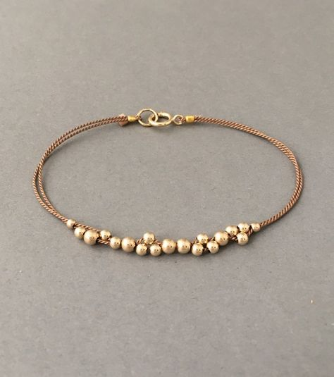 These bracelets are amazing on and look fantastic layered. Gold fill, rose gold fill, or sterling silver beads are uniquely threaded on a colored silk thread. Comes packaged in a jewelry box.