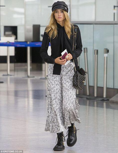 Suki Waterhouse rocks a retro look as she jets into the UK for London Fashion Week