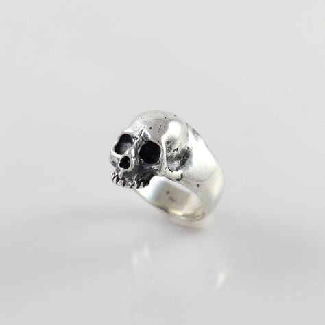 Sterling Silver Detailed Half Skull Ring This thick sleek band features a highly detailed half skull and is an instant classic. Thick, yet comfortable this will become part of your daily armor. Size 6 Available to order in sizes 6-12 Weight: 11 grams Length: 17mm Width: 13mm Height off finger:
