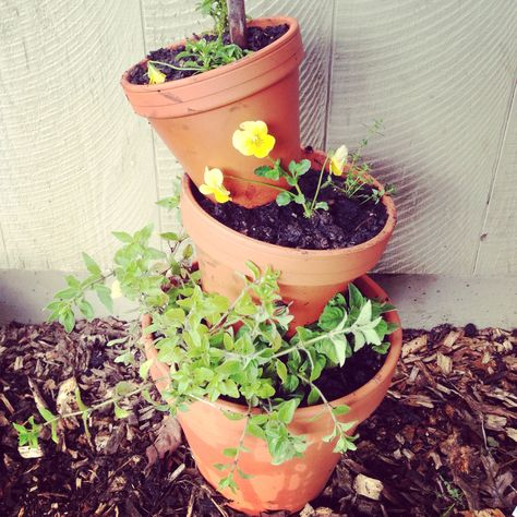 Terra cotta pot tower. Just need 3 pots large, medium and small. Also one stick to put through each pot. Easy peasy.