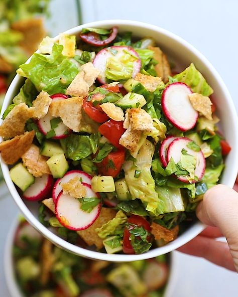 This delicious fattoush salad has vegetables, fresh herbs, crispy pita bread and a sumac dressing. Great as an appetizer or served with protein for a meal.