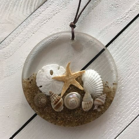 Excited to share the latest addition to my #etsy shop: Seashell ornament resin #coastalliving #largeresincharm #resinbeachornament #beachliving #beachtheme #beachthemedecor #shellornament #ornament