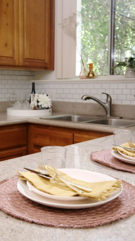 Who says you can't renovate a kitchen on a budget? Not us! We love using these peel-and-stick tiles to mix things up. Your wallet will love them too. 😉