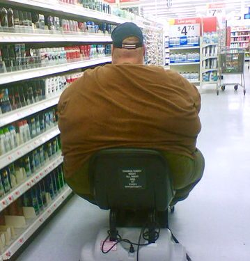 Wal Mart fun with electric carts... This guy is sooo fat, he needs two carts to carry his fat ass around!