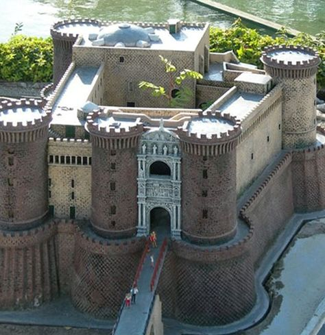 """Castel Nuovo (""""New Castle""""), aka Maschio Angioino, Piazza Municipio, Naples, Italy.  http://www.castlesandmanorhouses.com/  Castel Nuovo's scenic location and imposing size makes the castle, first erected in 1279, one of the main architectural landmarks of the city."""