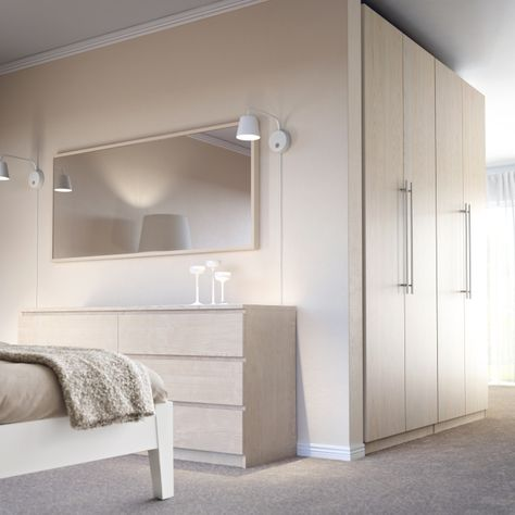 PAX NEXUS and MALM furniture combine for a cool and contemporary look.  With PAX wardrobes, you can choose your color, finish, and whether you want sliding or hinged doors, so your bedroom is stylish, functional, and made just for you!
