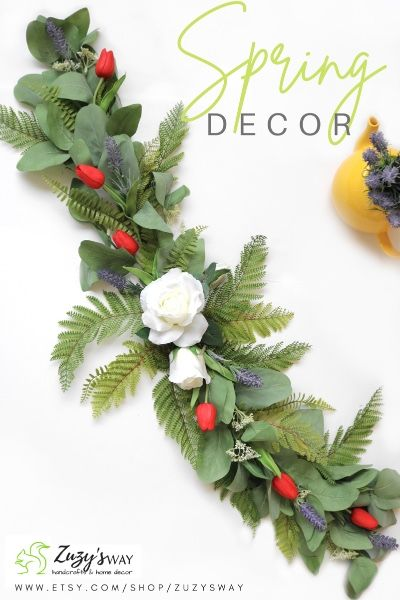 🌿Celebrate spring season by bringing nature into your home! Decorate your home with spring nature finds and the gorgeous evergreen garland featuring natural looking seeded eucalyptus, fern, real touch red tulips, a gorgeous white rose and a drop of lavender #garlandformantle #manteldecor #fireplacedecor #fireplacegarland #greenerygarland #Eastergarland #springgarland #springfireplace #springtablerunner #springtablegarland #rosesfloralgarland #floralmanteldecor #springswag