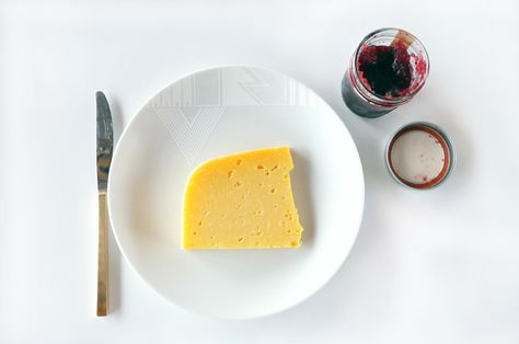 White Noise by Alyson Fox for Ink Dish dinner plate with cheese.