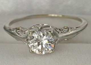 love the antique setting of this ring