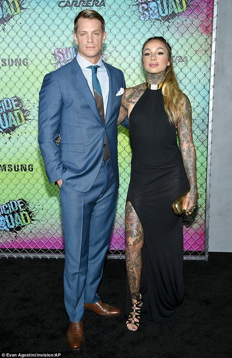 Date night: Joel was joined by his tattoo artist wife Cleo Wattenstrom, who wore a black gown with gold choker neckline