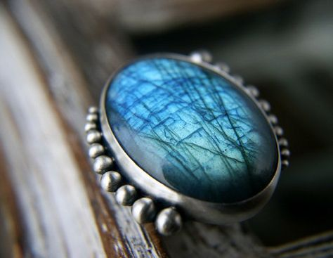 I think grandma would have like this as a broach :) Night Forest Aglow - Labradorite Sterling Silver Ring by MercuryOrchid
