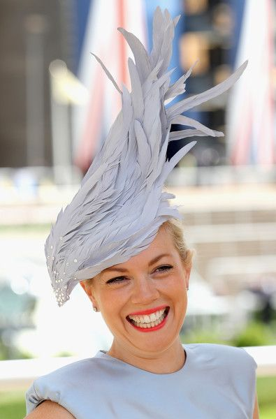 A lady arrives for the second day of Royal Ascot at Ascot Racecourse on June 15, 2016 in Ascot, England.