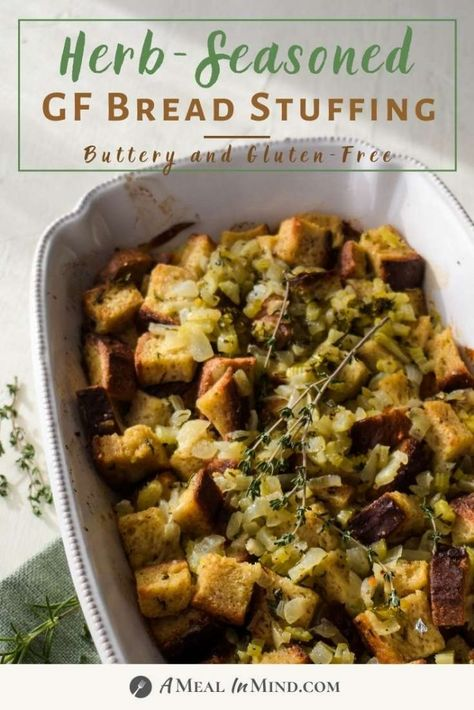 This flavor-packed herbed gluten-free stuffing is aromatic with sage, rosemary, onions and celery. Stop buying packaged mixes - have fun with homemade! So easy to stir together and then bake for any holiday. | A Meal In Mind #amealinmind #stuffing #glutenfreestuffing #holidaystuffing #breadstuffing #thanksgiving #thanksgivingside #thanksgivingstuffing