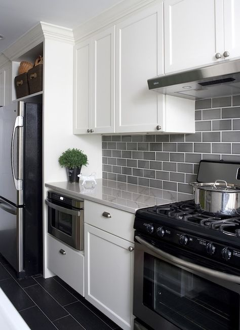 I like this back splash, flooring, and the built in space to house the fridge. Also, love white cabinets in a kitchen.