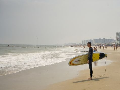 Surfers at Rockaway Beach in NYC