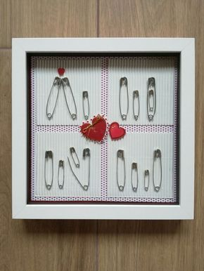 Gift for pregnancy / birth. Made with safety pins and deep picture frame :) Quick & easy