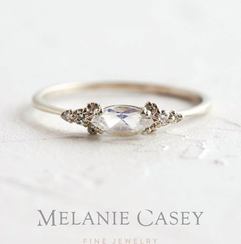 A white gold moonstone ring featuring a marquise cut center accented by clusters of white diamond on a delicate band Find the Moonstone Eyelet Ring at Alternative Engagement Rings, Vintage Engagement Rings, Vintage Rings, Diamond Engagement Rings, Antique Wedding Rings, Vintage Jewellery, Antique Jewelry, Unconventional Engagement Rings, Different Engagement Rings