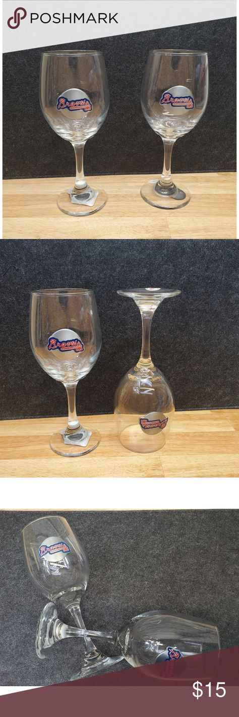 Great American Products Atlanta Braves MLB 2pc Win American Products Atlanta Braves Original MLB Gift set contains 2 wine glasses decorated with high-quality metal logos. Each glass holds 14oz with sophisticated styling that works great with whites, reds or a mimosa, new with tag and official seal and serial number, closeout outlet merchandise in good condition. MBL Dining Drinkware