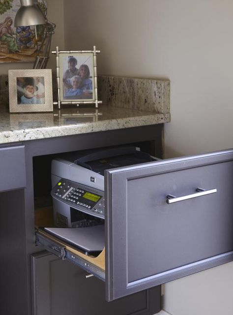 Adjust the sides of the drawer and put a printer in!