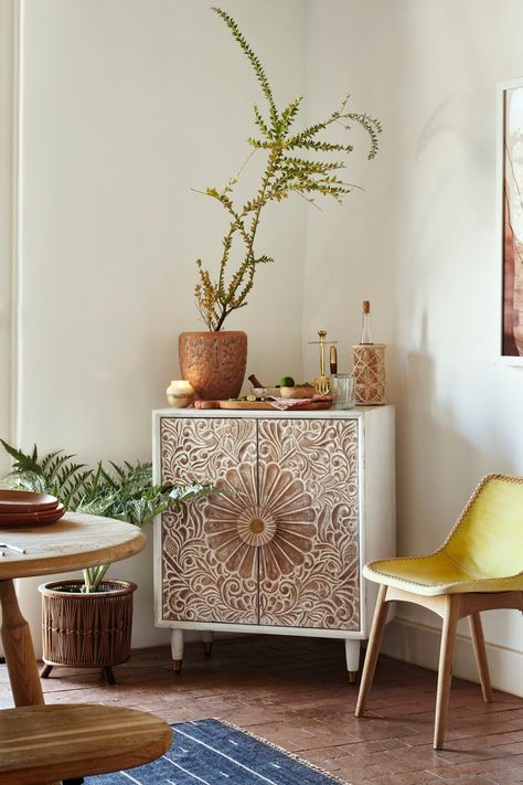 If you're settling for a bland, simple cabinet, you're missing an opportunity to give your storage some flair. Don't hide your storage—show it off with a piece with refined yet casual details, like Anthropologie's Gulliver Entryway Cabinet.