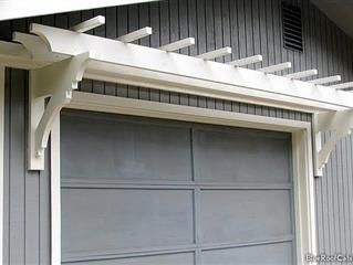 This Trellis Resting Atop Your Garage Door Not Only Gives Instant Visual Appeal To Your Home S Appearance But I Garage Door Trellis Garage Trellis Diy Trellis