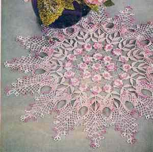 vintage doily, flowers & leaves. this is a very interesting doily, i've never seen one quite like it- the shapes draw your attention instantly