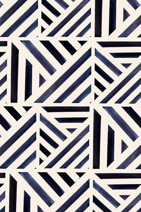 Bold watercolor stripes triangle pattern.  These bold blue lines can modernize any drab home decor!  Available in fabric, gift wrap, and wallpaper.  Click the pin to see more beautiful patterns like this one.