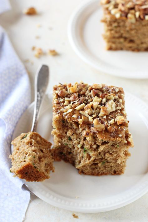 Moist and fluffy honey cinnamon zucchini bread! With whole wheat flour, applesauce and walnuts! Perfect for breakfast, snacking or even dessert!