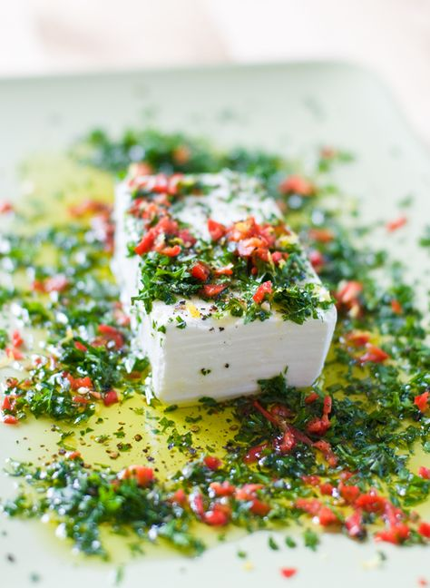 Great Holiday Appetizer recipe ~  feta topped with chilli, lemon, olive oil,  fresh oregano, thyme and parsley.  Serve with warm crusty bread to spread.