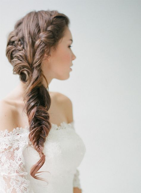 ornate yet relaxed wedding hair looks perfect with this off the shoulder dress.