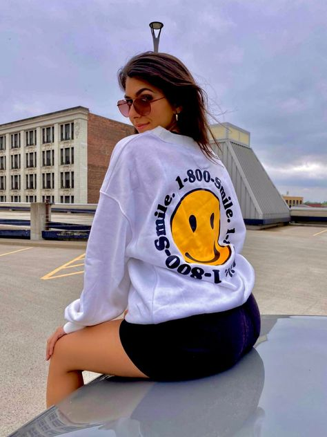 Smile Crewneck Fleece Lined 75% POLYESTER, 25% COTTON Model Info: Height: 5'3 Bust: 32C Model is wearing a size Large