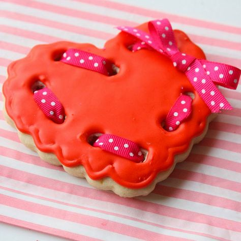 Use these ribboned cookies as cute edible Valentine's Day decorations.