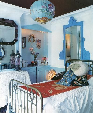 Blue boho bedroom, so pretty.  The painted and gilded blue paper lantern and the pale blue painted built-in are magical.  The lace tablecloth, interesting mirrors, contrasting bed blanket, all add up to lovely.  Would make a perfect guest room or hotel room with a mini-fridge in the corner.