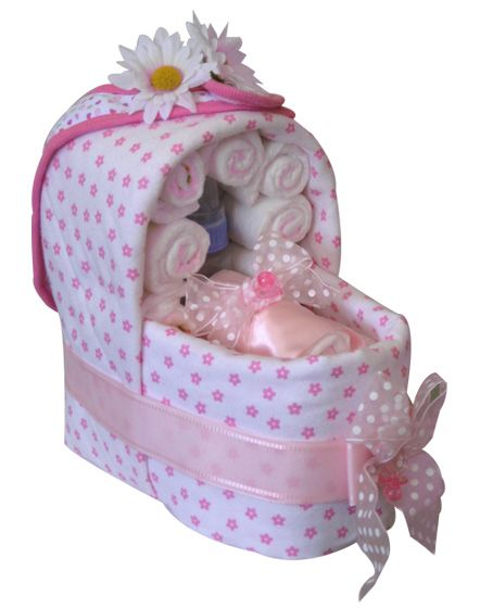 Cute baby shower gift, a bassinet made of diapers and baby accessories.