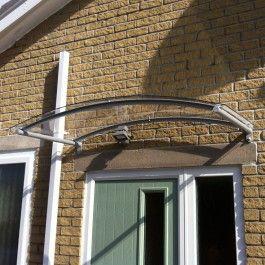 modern door canopy mounted over double timber door exterior