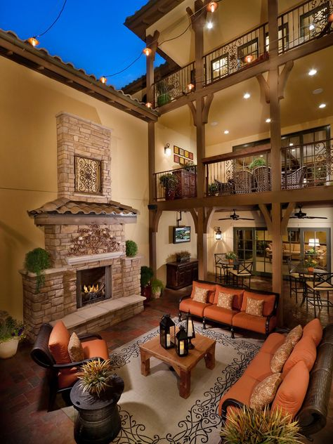 The extravagant patio outside this three-level home features a gorgeous outdoor fireplace and cozy outdoor seating. The two balconies overlooking the patio also feature outdoor seating for endless entertaining opportunities.