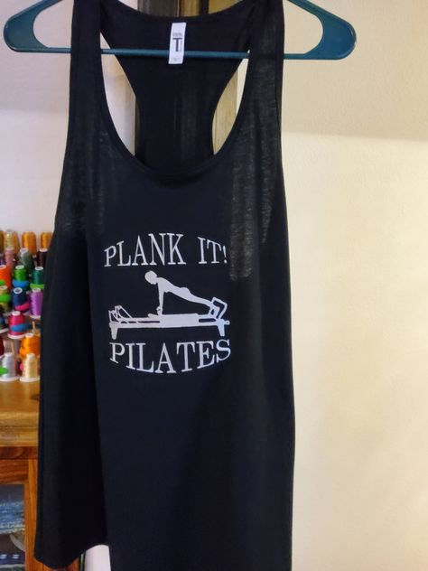 This ultra comfortable racerback Top is custom embroidered with the rather challenging Plank on the Pilates reformer. Fun to wear and to work out in. Top is constructed with: 3.9 oz., 60/40 combed ring spun cotton/polyester, 30 singles Fabric laundered Self-fabric binding Curved hem Side seams Tearaway label These shirts tend to be more fitted and run small.
