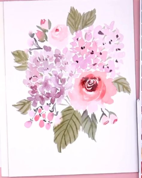 Learn to paint a step by step hydrangea and watercolor rose bouquet with this easy to follow tutorial by Snowberry Design Co on YouTube